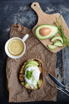 Pouched egg on toast with sliced avocado and lemon tea in rustical style - healthy breakfast - photo is available on Shutterstock - Stock photo ID: 769611541
