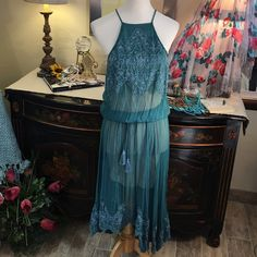 Free People Brand New Dark Teal Chiffon Maxi Dress Free People Brand New with Tags Gorgeous Teal Chiffon Boho Maxi.  Sheer Maxi meant to layer over a slip or camisole Flows beautifully!  Drawstring waist.. Super feminine Free People Dresses Maxi