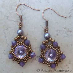 """Wisteria Rivolis    These dainty beaded earrings showcase a pair of vintage Swarovski rivolis in stunning """"Wisteria"""" which is a pale orchid with amazing flash and sparkle. Set in beaded bezels comprised of tiny bronze colored seed beads and accented with Swarovski crystal beads and freshwater pearls. They dangle about 1.25"""" long, and they hang from Frech hook earwires in antique copper."""