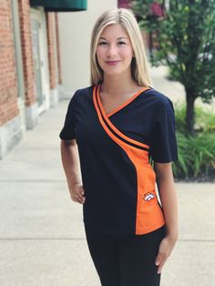 Denver Broncos Mock Wrap Scrub Top with Two Front Pockets Cleaning Uniform, Denver Broncos Womens, Cute Scrubs, Scrubs Outfit, Uniform Design, Medical Scrubs, Scrub Tops, New Woman, Fashion Outfits