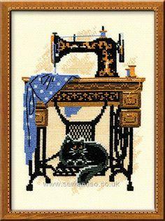 Singer sewing machine + Cat