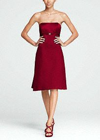 Traditional elegance meets modern decadence in this sensational satin dress reminiscent of Old Hollywood glam !   Strapless satin bodice features sparkling brooch and empire waist that helps create a stunning silhouette.  Pleated and tie back detail adds dimension and finishes off the look.  Fully lined. Back zip. Imported polyester. Dry clean.  Sizes and colors have availability.