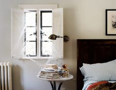 Inside a Spooky Home:   In October, this home springs to life, with cutout bats taking flight across walls and alighting on table settings By Joe Bargmann.  Bedside Table:   In the master bedroom, faux spiderwebs ($1.69 a pack; peanutandmagoos.com) transform a milk-glass topped side table into a spooky still life. Tovin designed the elm veneer headboard.  Photo Credit: Mikkel Vang
