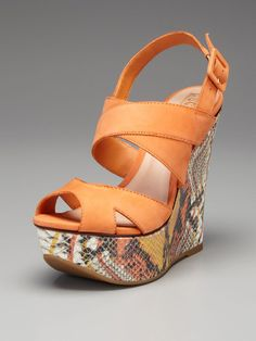 Love the orange and snakeskin print mix of these wedge sandals.