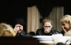 warning - extremely graphic- Mourners grieve at coffin of Markin, regional parliament deputy who died in fire at trade union building on Friday, at his funeral in Odessa...