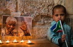Candles are placed in front of the image of the late South African leader Nelson Mandela during a vigil by Palestinians and members of the African community in Old City of Jerusalem. Nelson Mandela, Activities To Do, Old City, Africa Travel, Mount Rushmore, Jerusalem, Pictures, Candles, Community