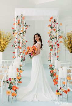 A bright modern wedding aisle gorgeously done with white chairs, colorful blooms in orange and rust, candles on tall stands. A bright modern wedding aisle gorgeously done with white chairs, colorful blooms in orange and rust, candles on tall stands. Wedding Ceremony Ideas, Wedding Aisle Decorations, Ceremony Backdrop, Wedding Events, Wedding Aisles, Floral Wedding, Wedding Colors, Wedding Flowers, Wedding Dresses