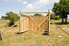So, my first job as a certified Doctor: build a horse shelter. Searching for ways to make money this Summer I posted an ad on Craigslist fo. Horse Run In Shelter, Rv Shelter, Shelters, Horse Stalls, Livestock, Way To Make Money, Garden Bridge, Outdoor Structures, Horses
