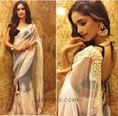 Former Miss India Vartika Singh in Neeta lulla half and half saree at a recent awards event.She looks eye catchy in white and black half and half saree wit