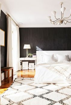 A large Moroccan Beni Ourain rug can create a dazzling effect, particularly in a dramatic black-and-white bedroom like the one above. The plush texture and soft ivory tones soften up the high...