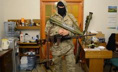 Armed terrorist posing with lots of guns