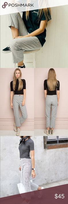 """NWOT Brandy Melville Grey Striped Tilden Pants NWOT. High-rise trouser pants in white and grey stripes with a button and zipper front, elasticized waistband, and a slit on the back hem. Measurements: 10"""" rise, 25"""" inseam, 12"""" waist (stretch) Brandy Melville Pants Trousers"""