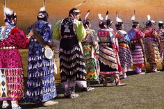 Blurb Book, costumes, feathers, rituals, dance, women, traditional dresses, sunsets.. Click on link below for information