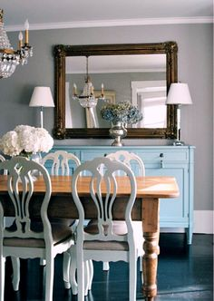 Paint dining room chairs white ,  beige upholstery and side table this light blue.   Love the Dining Room Chairs and the blue sideboard....just lovely!