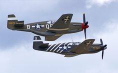 """Two early-model Mustangs fly in formation at Chino: The Planes of Fame Museum's P-51A led the P-51C """"Boise Bee"""" from Warhawk Air Museum of Nampa, Idaho."""