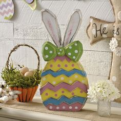 Hatch into the spirit of Easter with our Wooden Bunny Egg Statues, and add a whimsical feel to your Easter decor. With bold colors and a combination of many Easter staples, they are must-haves for your Easter decor.