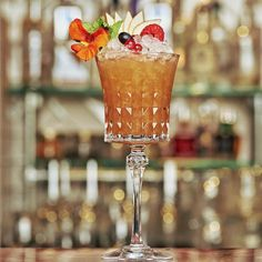 Sherry Cobbler - one of the retro drinks at The Resting Room @distilleryldn from a 1846 recipe from The London Daily News With Oloroso Sherry, fresh lemon, sugar, pineapple and seasonal fruit #sherry #sherrycocktail #glassware #distillerylondon #cocktails #londonscocktails #mixology #serves #garnish #fruitgarnish #retrococktail