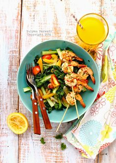 Garlic and Chili Prawn Skewers & Tatsoi Stir Fry Recipe by Cooking With Love
