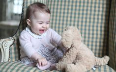 Photographs taken by Duchess of Cambridge showing her second child howling   with laughter as she snaps away are released by Kensington Palace