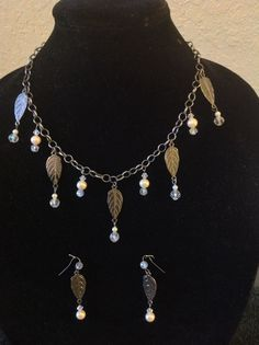 A Victorian inspired set . pewter finish metals ,glass pearls and crystals. Find this @ www.the-violet-rose.com