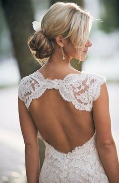 Beautiful lace wedding dresses like these  have an open back to make sure the lace isn't too much