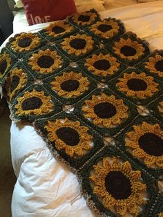 Handmade crochet sunflower afghan. Summer loving cheerful sunflower blanket. Made with love. 100% soft acrylic. This would look great across your bed, couch or rocker. This blanket is a unique granny square using golden yellow, forest green and brown yarn. Girly shell edging in