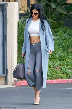 Learning from her sisters: Kylie Jenner was seen walking out of momager Kris Jenner's management company in Calabasas, California on Monday