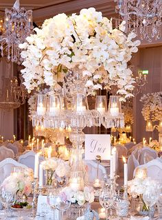 A fantasy setting for my Birthday, perhaps? Orchids, roses, candles and crystal. Champagne anyone?