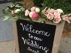 Flowers adorn the board welcoming Amanda & Andrew's guests to the Darby House www.bloomtasticweddings.com