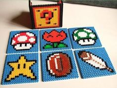 8 bit video game on a grid. this is in perler beads, but what about a quilt? hmmm....