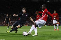 Frenchman Paul Pogba (right) unleashes a left-footed shot at goal ahead of the challenge of 28-year-old Sivakov