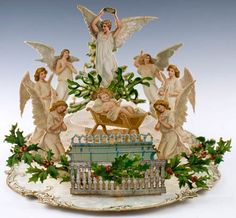 A Joyful Christmas to You. London, Paris & NY: Tuck, Raphael, (c. 1895-1901). A stunning pop-up Christmas card that opens to reveal a four-tiered nativity scene, in which seven angels surround the Christ Child.