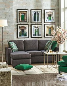 06 charcoal grey sofa grey stone floors and emerald and gold details for a chic