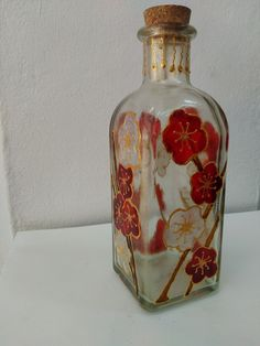 Botella de vidrio pintada a mano