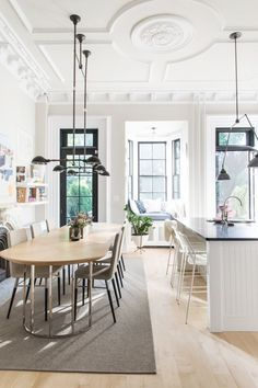 beautiful neutrals in the dining room and kitchen with modern furnishings and industrial lighting coco+kelley-brooklyn brownstone home tour House Design, House, Brooklyn Brownstone, Home, Brownstone Interiors, Elegant Kitchens, House Interior, New York Brownstone, Interior Design