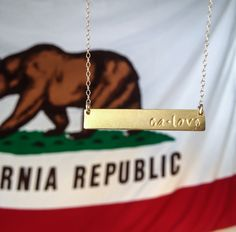 "Represent the Golden State in style!  Would you wear this gold ""CA Love"" necklace? Buy it at calimited.com"
