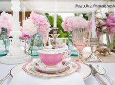 Adorable tea party theme with mismatched, but complementary tea cups :)
