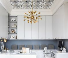 OFFICE- The cool light fixture, fun ceiling wallpaper and functional, clean cabinets, could be something to think about