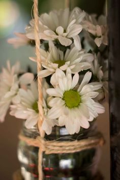 Beach wedding white daisies in a jar