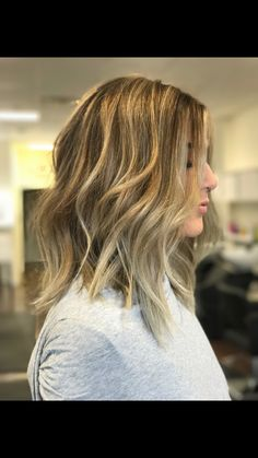 Springtime inspiration! Beautiful, hand-painted balayage and refreshing gloss by Kristin with a sexy, texturized lob by Lacie
