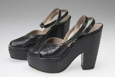 Black snakeskin platform peep toe sandals, ca. 1946. Possibly made by Salvadore Ferragamo. Wedges and platform shoes were overwhelmingly popular in the 1940s. However, the tall platform of these sandals, snakeskin leather, and straps that reveal many areas of the foot, suggesting that these shoes were made after the war, as they defy all fabric sanctioning and fashion restriction guidelines. The war coming to a close gave designers more freedom to indulge in quality fabrics and expressive…