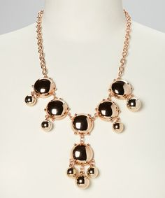 What's an outfit without a genuine statement piece? This collection of lustrous globes along a polished chain creates a striking and original look.18'' long with 4'' extenderZinc alloy / resinImported