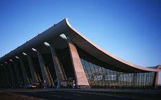 Dulles International Airport (for Washington DC) in Chantilly Virginia, designed by Eero Saarinen.