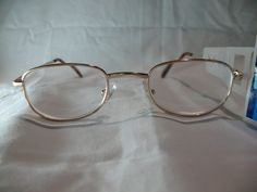 We believe designer reading glasses should be affordable. We carry all colors, shapes, and sizes. This is a pair of Foster Grant Spare Pair gold colored reading glasses. These glasses have oval shaped lenses and brown tortoise colored temple tips. | eBay!