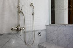 """Waterworks Easton exposed thermostatic shower system is featured in this luxurious steam shower. Walls are a blend of large scale polished carrara marble and 5/8"""" thassos mosaics."""