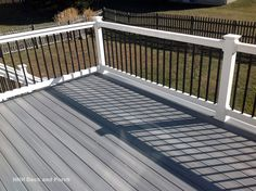 Composite deck using Fiberon castle grey decking with white PVC railing and black square aluminum balusters. Vinyl Deck Railing, Pvc Railing, Cable Railing, Railing Ideas, Black Railing, Porch Railings, Decking Ideas, Fence Ideas, Patio Ideas