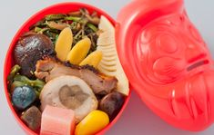 Dharma lunch == train station bento. Container can be used as piggy bank.