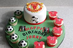 Manchester United Birthday Cake and Cupcakes.    Man U logo hand carved from fondant.  All cupcake toppers are made from fondant too.    More photos can be viewed on my FB Page www.facebook.com/happylbaker