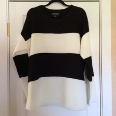 Striped sweater Black and white striped sweater. It's very soft and comfortable. 100% acrylic. Never worn. Would better fit 2x unless you want it to be fitted. New without tags. Forever 21 Sweaters Crew & Scoop Necks