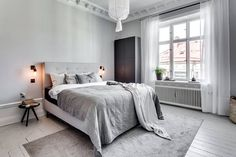 Gorgeous small bedroom design with white color.